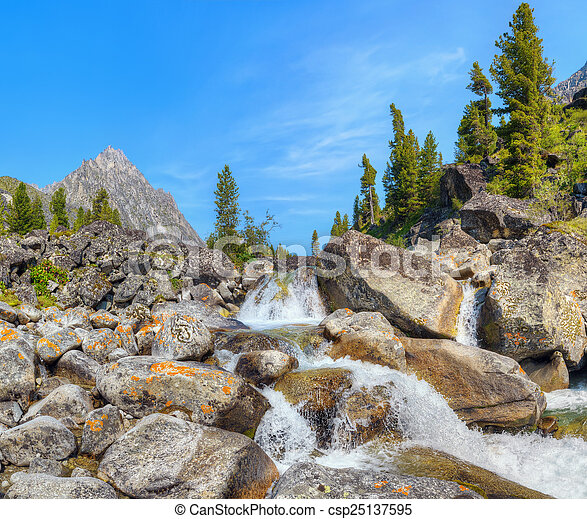 Small cascade of waterfalls on a mountain creek - csp25137595