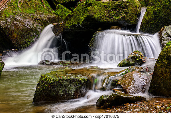 small cascade on the river among bouders - csp47016875