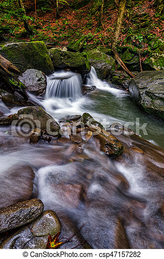 small cascade on the river among bouders - csp47157282