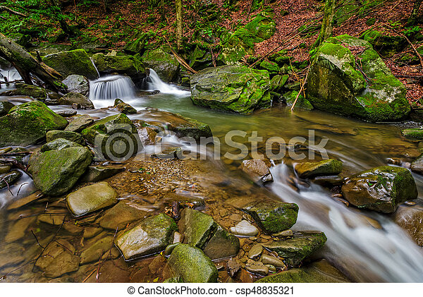 small cascade on the river among boulders - csp48835321