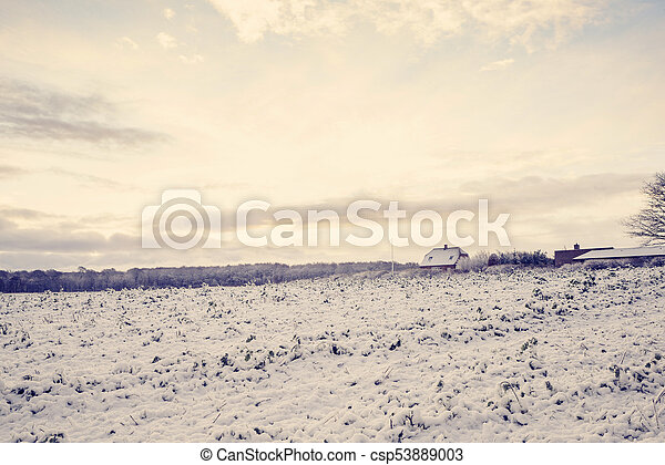 Small farm house in a rural scenery with sunrise - csp53889003