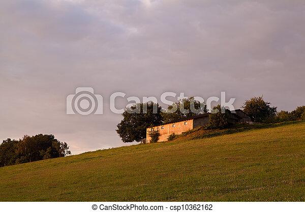 small farm on hill at sunrise - csp10362162