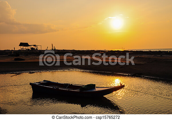 Small fishing boat on the beach - csp15765272