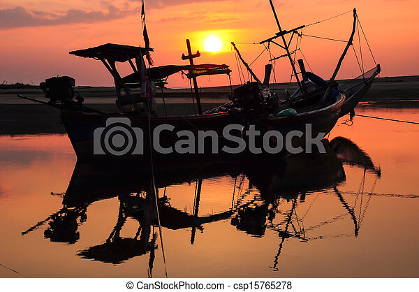 Small fishing boat on the beach - csp15765278