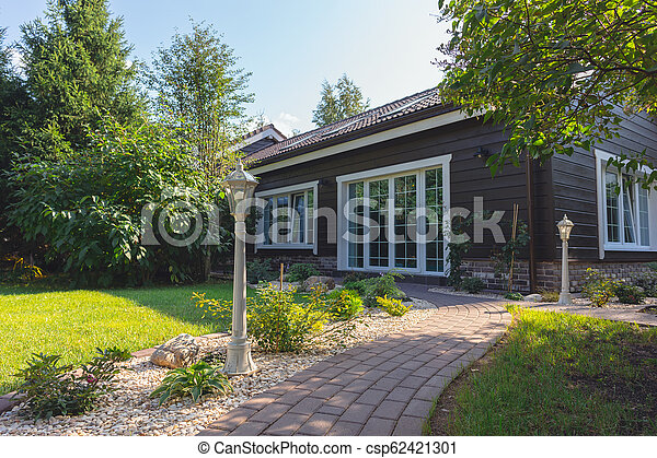Small garden in front of the countryhouse, summertime - csp62421301