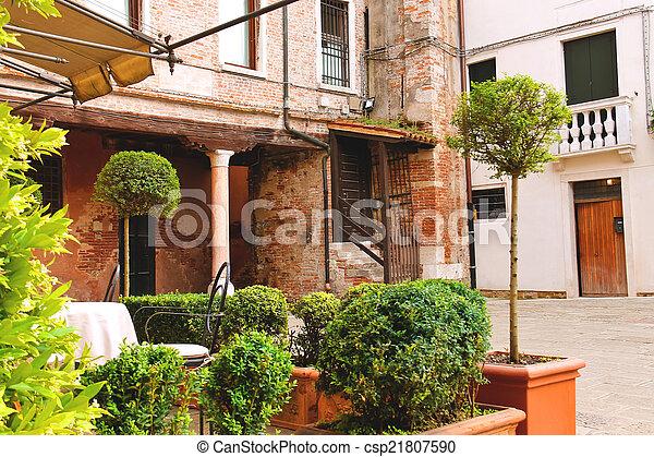 Small garden in the courtyard of the Italian city - csp21807590