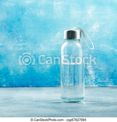 Small glass water bottle - csp67627694