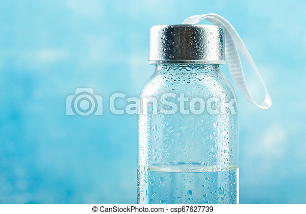 Small glass water bottle - csp67627739