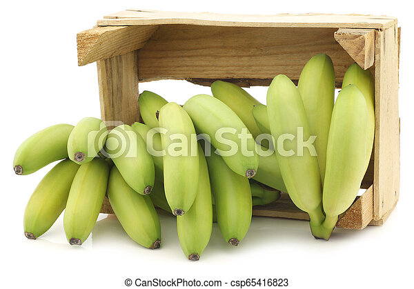 small green snack bananas in a wooden crate - csp65416823