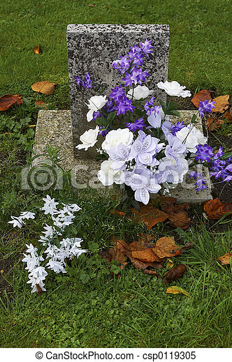 Small Headstone Purple And White Flowers On A Grave Batsford