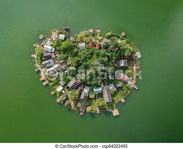 Small heart shaped island on a lake - csp64222493