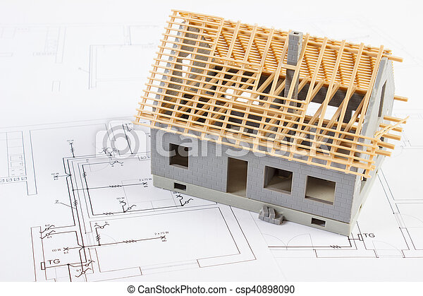 Small house under construction on electrical drawings, concept of building home - csp40898090