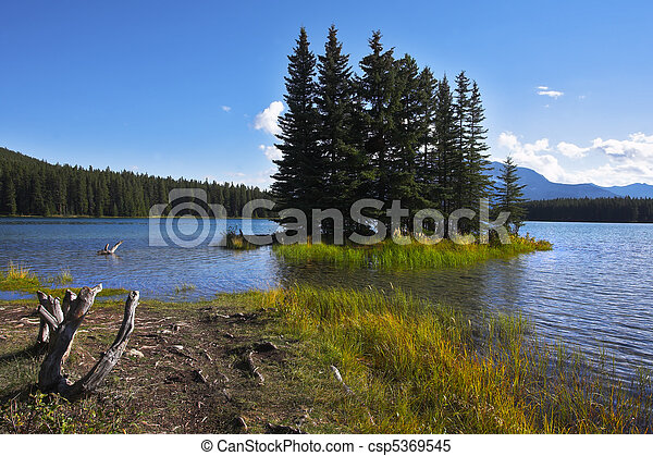 Small island on a shallow of the lake - csp5369545