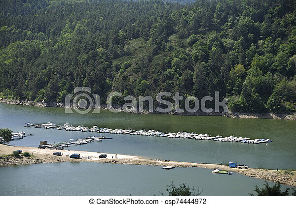 Small marina on a lake in the French region of Auvergne - csp74444972
