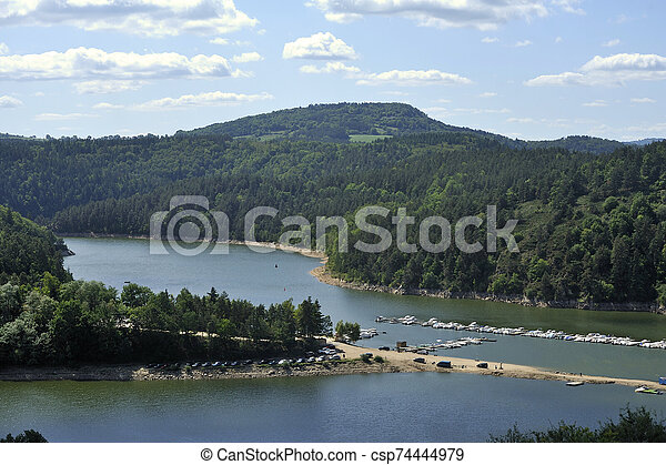 Small marina on a lake in the French region of Auvergne - csp74444979