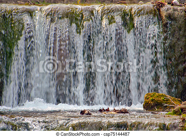small mountain waterfall in natural - csp75144487