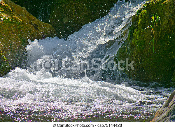 small mountain waterfall in natural - csp75144428