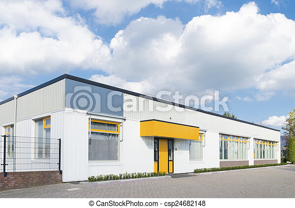 Exterior Of A Small Office Building With Yellow Entrance