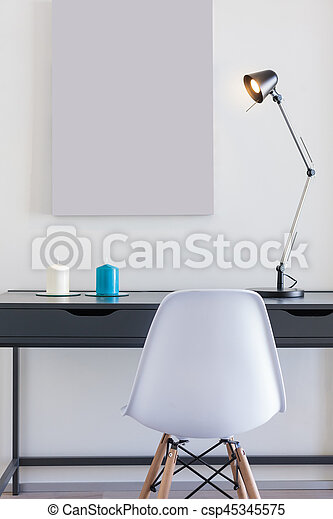 Small Office Desk With White Chair And Single Lamp   Csp45345575