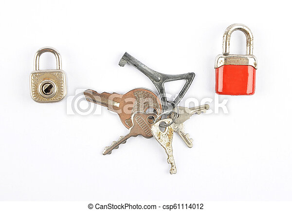 Small padlocks and bunch of keys on white background - csp61114012