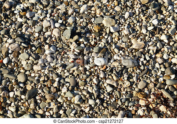 Small pebbles textured macro background - csp21272127