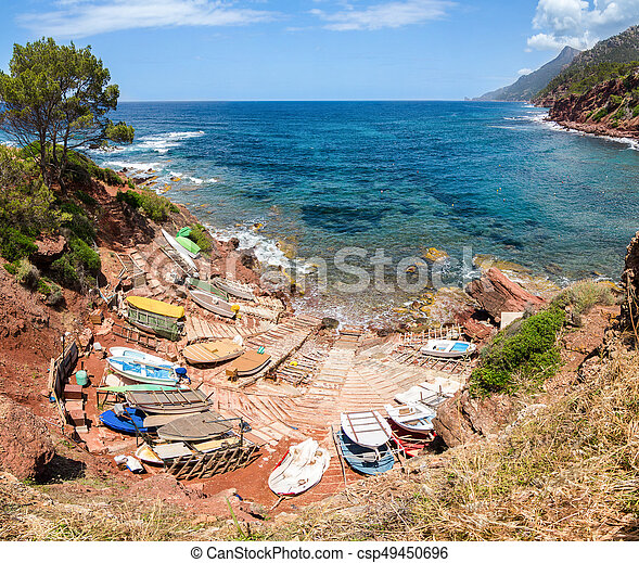 Small port with fishing boats. View over sea and mountains. - csp49450696