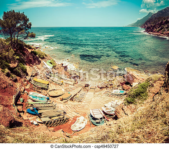 Small port with fishing boats. View to blue sea, mountains. - csp49450727
