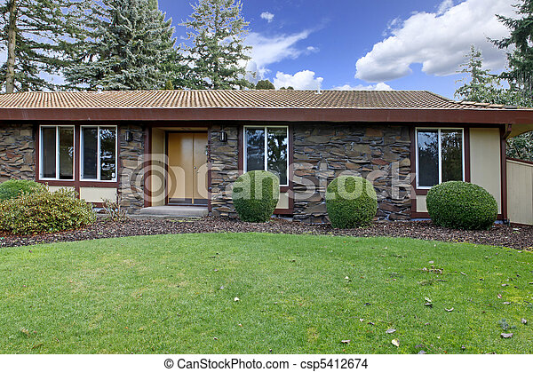 Small rambler house front shot small house with stone wall for Beautiful rambler homes