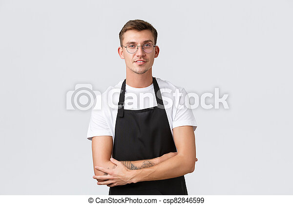 Small retail business owners, cafe and restaurant employees concept. Handsome barista, salesman in glasses and black apron, listening customer, waiter taking order, white background - csp82846599