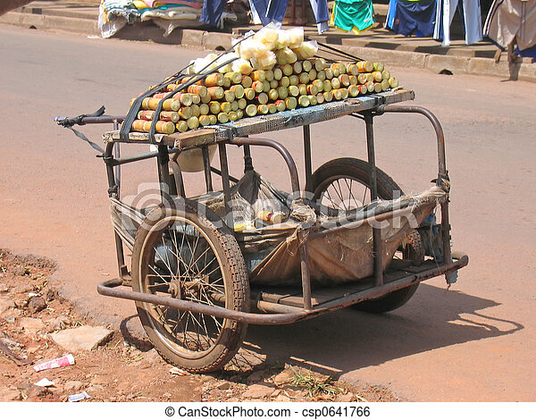 Small rural car with two wheels parked in the street to sell sugar cane, Cameroon, Africa - csp0641766