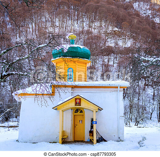 Small russian church at sunset in winter landscape - csp87793305