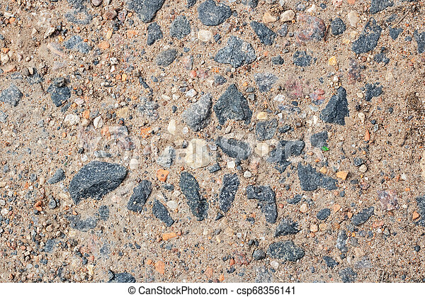 Small stones on yellow sand close up - csp68356141