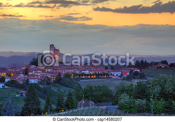 Small town on the hills at sunset in Italy. - csp14580207