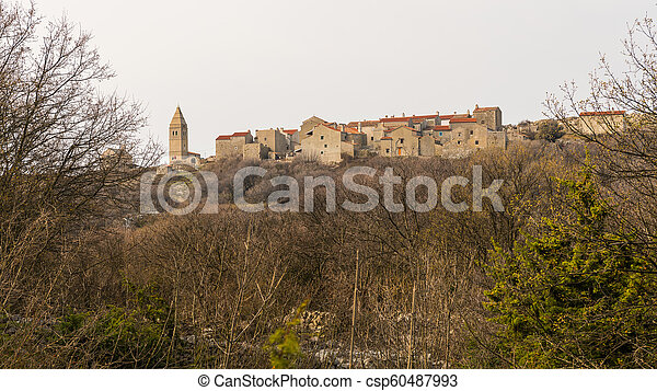 Small village of Lubenice on a cloudy day in spring - csp60487993