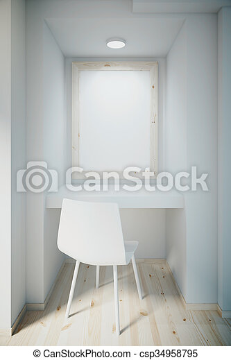Small white office with blank frame on wall - csp34958795