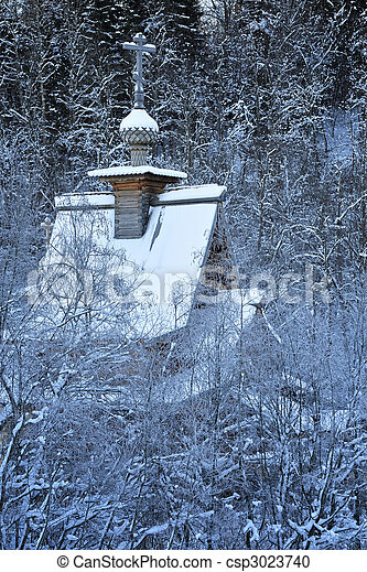 Small wooden church in a forest - csp3023740
