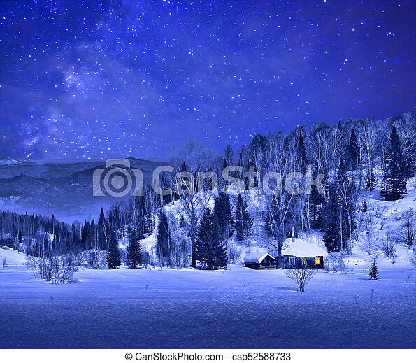 Small wooden house in a night winter mountain landscape - csp52588733