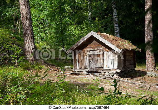 Small wooden house of forester on forest margin in Finnish reserve - csp7067464 & Small wooden house of forester on forest margin in finnish reserve.