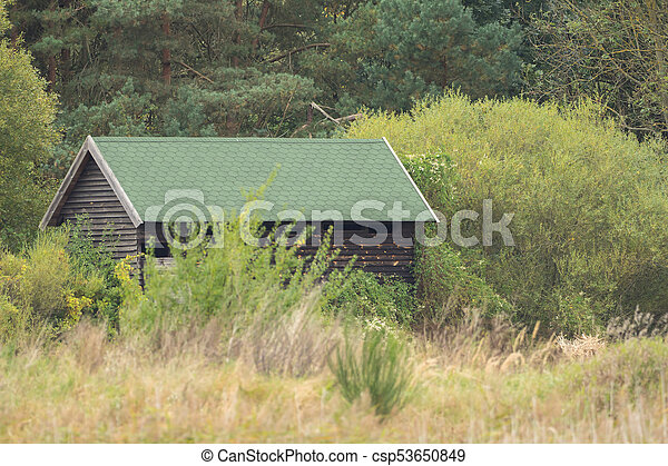 Small Wooden Hut In The Middle Of The Wilderness   Csp53650849