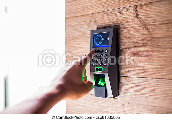 Smart home keyboard password entrance. Human hand pressing the security code combination to unlock the door. - csp81635865
