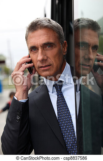 Smart man using a mobile phone - csp8837586