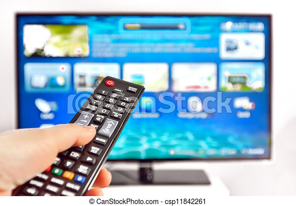 Smart tv and  hand pressing remote control - csp11842261