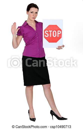 Smart woman with a stop sign - csp10490713