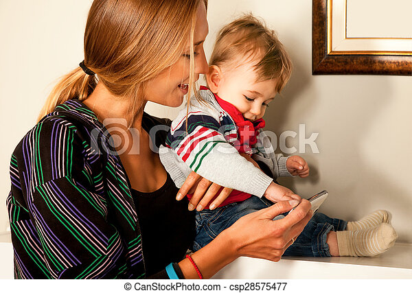 smartfone fun mother baby technology - csp28575477