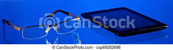 Smartphone Communicator for business, entertainment, glasses with diopters for reading ? necessary things. - csp69282698