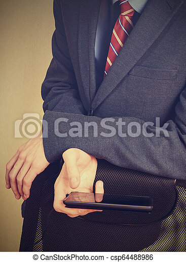 Smartphone in the hand of young man - csp64488986