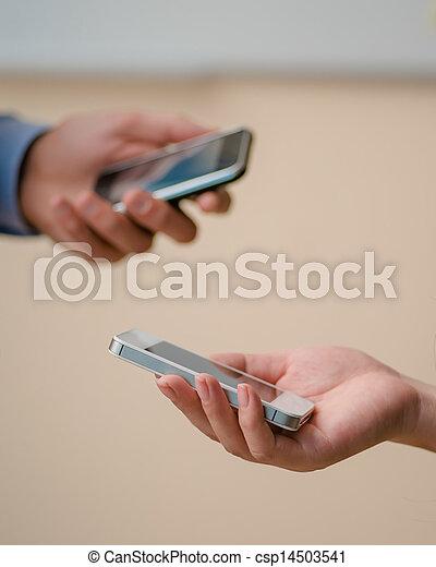 smartphones in the hands of - csp14503541