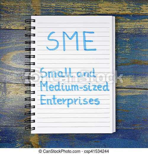 SME- Small And Medium-sized Enterprises acronym written in notebook on wooden background - csp41534244