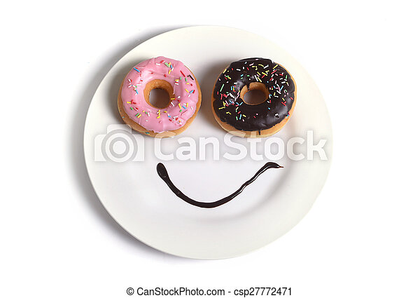 smiley happy face made on dish with donuts eyes and chocolate syrup as smile in sugar and sweet addiction nutrition - csp27772471