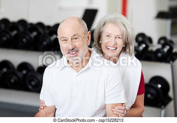 Smiling affectionate senior couple at the gym - csp15228213